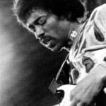 ** FILE **  On this 1970 file photo, Jimi Hendrix performs on the Isle of Wight in England. Vivid Entertainment is releasing a sex tape allegedly starring Jimi Hendrix. The Los Angeles-based adult entertainment company said they obtained the footage of the music legend shot in a hotel room about 40 years ago from a memorabilia collector. (AP Photo/FILE)